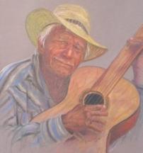 Hewey strumming the old guitar
